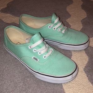 Bright teal Vans lace-up sneakers